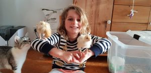 Jolan with two new baby chicks on her arms